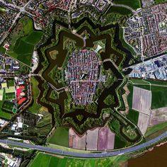 Naarden is a star fort in the Netherlands. The city was constructed in the manner seen here so that an attack on any individual wall could be defended from the two adjacent star points by shooting at the enemy from behind.