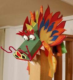 Careta de dragón chino para disfraz infantil, hecha con caja de zapatos y tapa forradas con papel verde, y a la q fuí añadiendo elementos . El resultado fue bastante espectacular...