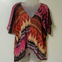 "'Charlotte Russe' colorful blouse Colorful Aztec design ""Charlotte Russe"" sheer & slightly Hi/Lo V-neck blouse. Great preloved condition! colors consist of multiple shades of; pink, cream, light & dark brown, black, orange, lavender. 100% polyester. Charlotte Russe Tops Blouses"