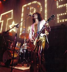 T.Rex - Now I love KISS, but wonder where they got the idea for the marquee KISS logo on stage...