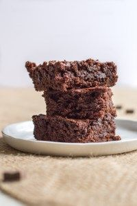 Vegan brownies made with both cocoa powder and chocolate chips provide a rich, fudgy treat.