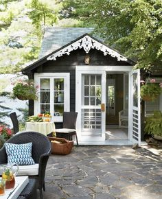 Flag stone patio, tiny cottage... This would be an AWESOME writing space.