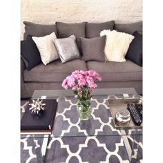 White and grey apartment living room & coffee table styling
