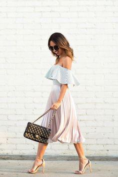 Pink midi skirt, stripes blouse, beige heels, black tote