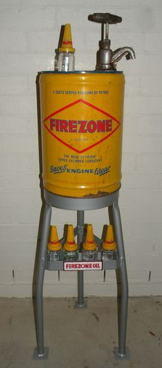 A Golden Fleece Firezone upper cylinder Lubricant stand and bottles