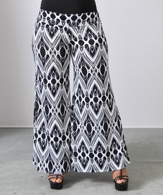 Soft, stretch-kissed fabric unites with a flowy silhouette to create these stylish palazzo pants, ready to form the foundations of multiple ensembles. Palazzo Pants, Harem Pants, Black And White Abstract, Black White, Lace Skirt, That Look, Skirts, Fashion, Pants