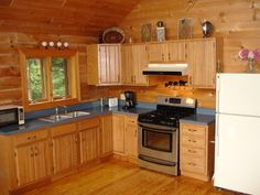 log cabin kitchens photos | You'll find everything you need in this cozy kitchen.
