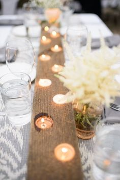 Aisle runner? buffet table?   Stunning tea light centerpiece adds a glow to your wedding decor | Paper Antler Photography