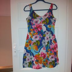 Description:Stunning vibrant floral dressZips at back.Look handmade.No label  Measurements (measure laid flat):across chest 18 inches / 46.5 cmsacross waist 15 inches /  39 cmsshoulder to hem 35 inches / 89.5 cmsPostage/Packaging:We will try to use recycled packaging or the most cost effective packaging. If you would like the item signed for please let us know.