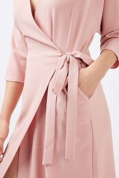 Stay true to this season's trends in this wrap dress. Featuring contemporary batwing sleeves and a tie waist for a flattering fit. #Topshop