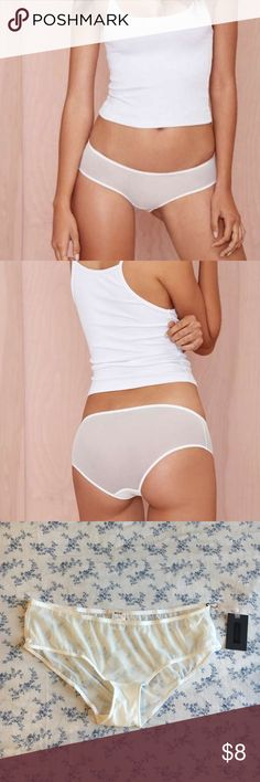 Nasty Gal Mesh Around Boyshort - White Introducing Nasty Gal Intimates – 'cause it's what's on the inside that counts (and sometimes peeks out). This white low rise boyshort features mesh detailing, stretch fabric, and partial lining. Wear it under your favorite dress or skirt for a seamless finish, or pair it with a white lace bra for a night with your boo.  *Nylon/Spandex/Cotton  *Runs true to size  *Model wearing smallest size  *Machine wash  *Imported Nasty Gal Intimates & Sleepwear…