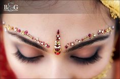 The bindi is arguably the most visually fascinating of all forms of body decoration. Hindus attach great importance to this ornamental mark on the forehead between the two eyebrows -- a spot considered a major nerve point in human body since ancient times. Also loosely known as 'tika', 'pottu', 'sindoor', 'tilak', 'tilakam', and 'kumkum', a bindi is usually a small or a big eye-catching round mark made on the forehead as adornment.