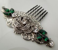 This vintage style hair comb has a rose with clear rhinestones. Pendant has been placed on a filigree and Swarovski emerald green and clear crystals