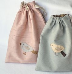 Strutting plummage - pale blue hand embroidered drawstring bag via Etsy.
