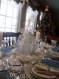 Snowflake Tablescape by dining delight, via Flickr.  The winter theme is a little much but I like the silver and crystal decorations on the blue tablecloth.