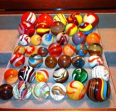 When I was little, we played together with marbles every day. Loved it! Marble Toys, Marble Games, Marbles Images, Marble Ball, True Art, Glass Marbles, Oxblood, Glass Ball, Oil Lamps