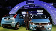 Pawan Goenka of the Indian manufacturing company Mahindra poses with the Verito Vibe compact car in Mumbai in 2013.