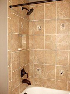 I like the shampoo niche under the shower head | Shower Tub Tile Design Ideas