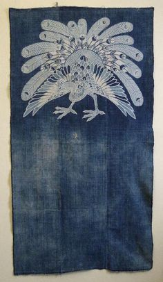 Indigo dyed cotton: An Elaborately Stencil Resist Dyed Peacock. The peacock was resist dyed, possibly using a set of stencils, the technique is called katazome. Or, maybe, this image was made using a combination of katazome with a free hand resist dyeing technique called tsutsugaki. Peacock1, srithreads