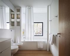 bathroom warmed up with wood tones against white