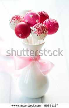 Love this idea for wedding cake pops!  Could give each guest a small vase with three or four cake pops in them, decorated in wedding colors.