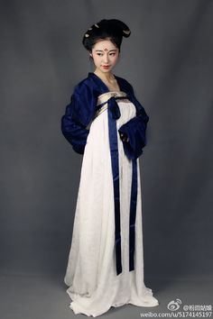 Tang dynasty; note the attention to detail in her hairstyle and makeup; you can match them to the earlier pins on Tang hair and cosmetics.