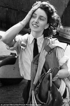 Maureen Dunlop leaving the cockpit of a plane she had just flown in 1944. The female pilots of the British Air Transport Auxiliary flew Spitfires, Hurricanes and Lancasters to air bases in England during WWII.
