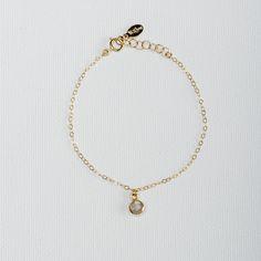 Labradorite Drop Bracelet. Dainty gold filled chain bracelet hangs a vermeil framed tiny faceted semi precious Labradorite stone. #Vilingdesigns #daintyjewelry #bracelets #womensfashion #style #jewelry #gold #Labradorite