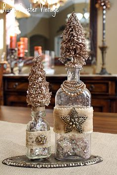 Tutorial on how to make these trees...bleached bottle brush trees, spray adhesive, then faux snow and Michael's champagne tinsel mixed together sprinkled on...very nice.
