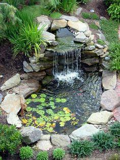 PEBBLE ROCK RIVER POND CASCADE WATER FEATURE AQUATIC PLANTING Small Backyard Ponds, Backyard Water Feature, Backyard Ideas, Backyard Waterfalls, Small Ponds, Small Patio, Backyard Patio, Patio Ideas, Rustic Backyard
