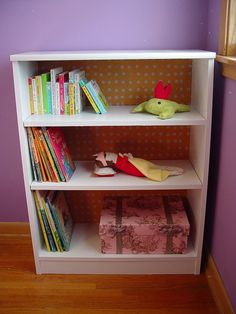 Bookshelf facelift: repaint and use mod podge and fabric or paper for back