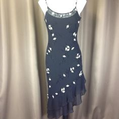 """Sue Wong black beaded dress Fully lined black silk dress with beautiful black beaded detail and ribbon roses throughout. Dress has asymmetrical ruffled hem, adjustable straps, and lining has a bit of stretch. Side zip, measurement from shoulder to longest part I'd hem is approx 46"""". Dress is in excellent condition and was probably only worn once. Sue Wong Dresses"""