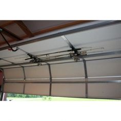 Garage door mount fishing pole holder, and my husband thought Pinterest was the devil, until he saw this