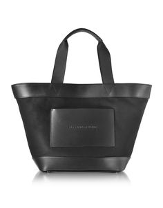 Black Canvas Tote crafted in water resistant coated canvas and leather, is sure to be a Wang Squad staple that works hard and plays harder. Featuring rubberized webbing handles with vachetta trim details, leather bottom with protective feet, large leather logo embossed pocket, center snap closure, interior zip pocket and silver tone hardware. Signature dust bag included.