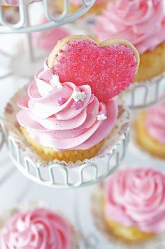 pink cupcakes with sugared heart cookie toppers.. So sweet. Cute for baby girl shower or tea party too