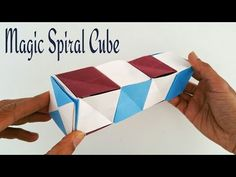 """How to make a paper Magic spiral cube - Modular Origami Tutorial. This Video Tutorial teaches you to make an Origami """"MAgic Spiral Cube"""" which is addictive and fun playing with this model. I have made 5 cubes, but you can add as many as you . Origami Design, Diy Origami, Origami Toys, Origami Cube, Origami Swan, Origami Paper Art, Origami Dragon, Origami Wedding, Useful Origami"""