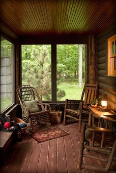 Screened in porch/room with beautiful wood floors and ceiling. I love the chairs on the right, but rocking chairs would look great also.