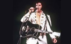 A guitar played by Elvis Presley in his final Las Vegas show and a dazzling   array of outfits worn by Michael Jackson are on offer in an auction of   Hollywood memorabilia.
