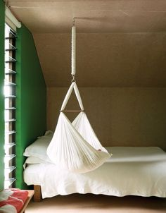 For now, one-year-old Awa is small enough to sleep in the hammock that hangs from the ceiling.