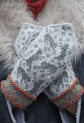Mittens and a hat in the Nordic tradition, but with a twist, cute little cats are dancing all over the mitts, with little paw prints on the inside. The cuffs are decorated with two-color Latvian braids, and a small stranded pattern.