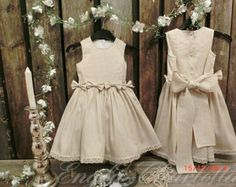 This linen flower girl dress in off white, would look great in a woodsy, natural and organic wedding. A ruffle dress for girls is perfect for