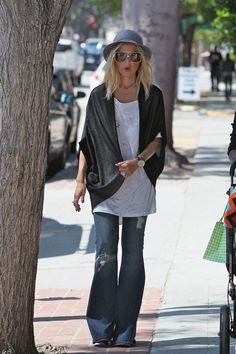 Rachel Zoe hat white top black cardigan jeans sunglasses