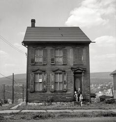 "August 1940. ""Old house in Upper Mauch Chunk, Pennsylvania. In the background is East Mauch Chunk."""