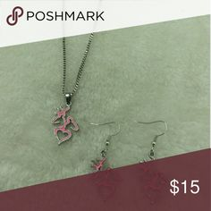 Pink browning dual deer head earring and necklace Adorable earring and necklace set!   It features a pink browning dual deer head necklace that has a buck and doe facing away from each other, with the bottom shaping into a heart.   The pendant itself is an inch long and 3/4 inch wide   The earrings are hook back style and each one is 1 inch long and 3/4 inch wide.  17 inch chain on necklace Jewelry