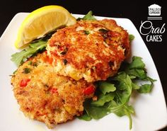 This Paleo Crab Cake recipe has a tasty lemon vinaigrette sauce that goes great over a bed of baby arugula. Makes a perfect appetizer or main dish! http://www.paleocupboard.com/crab-cakes.html