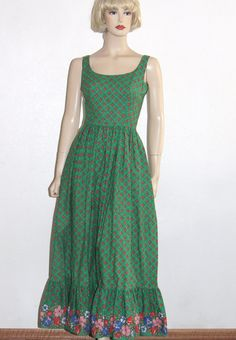 Stunning bright green Maxi sundress by Albert Capraro. The tag size is 8 and the dress is in excellent condition with no flaws or odors noted. Im not sure that it was ever worn. The dress has a fitted waist, scoop neckline front and back and hem ruffle with a larger floral print. The fabric feels like cotton and dry cleaning is recommended. Albert Capraro designed for many famous people including First Lady Betty Ford. Please write me if you have questions.  Bust: 35 Waist: 24 Shoulder to…