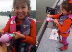 Dad encourages daughter as she catches a huge bass with her Barbie fishing rod