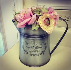 watering can vase - decorating a rental kitchen