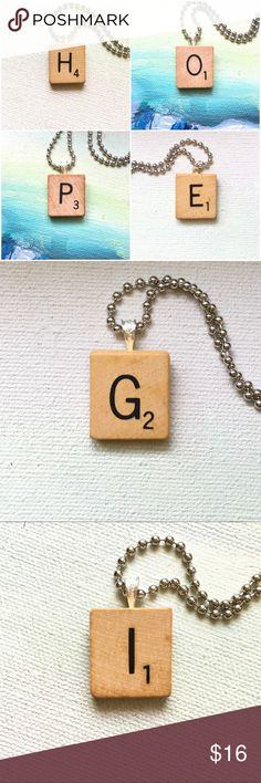 "Scrabble® Tile Custom Pendant Necklace Pick your letter and chain length!   These are genuine 1953 vintage Scrabble® tiles. They have been left unsealed and showcase the natural patina. They make a perfect sustainable personalized piece of jewelry!  Details: 1"" Scrabble® tile Choose your length ball chain  Please allow 2 days to ship as these are made to order. Frost and Fire Jewelry Necklaces"