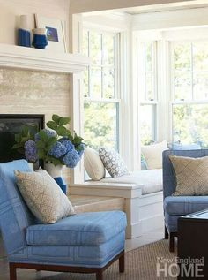 Blue and white living room with blue hydrangeas.